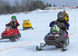 Snowmobilers brave icy winds to race on the lake