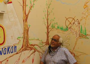 Kwakiutl artist paints mural in Friendship Centre
